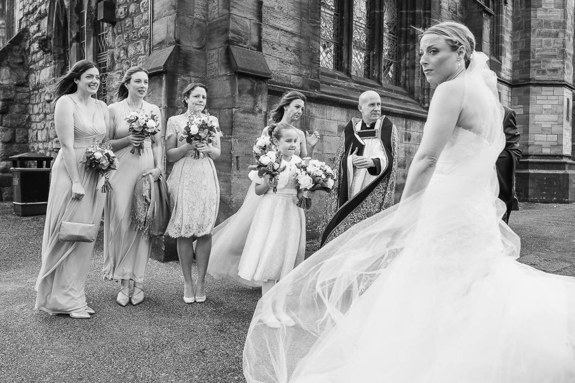 The bride and bridesmaids outside the church