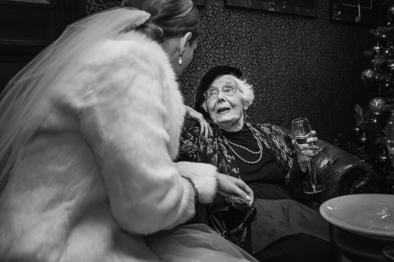 The bride talks with grandma