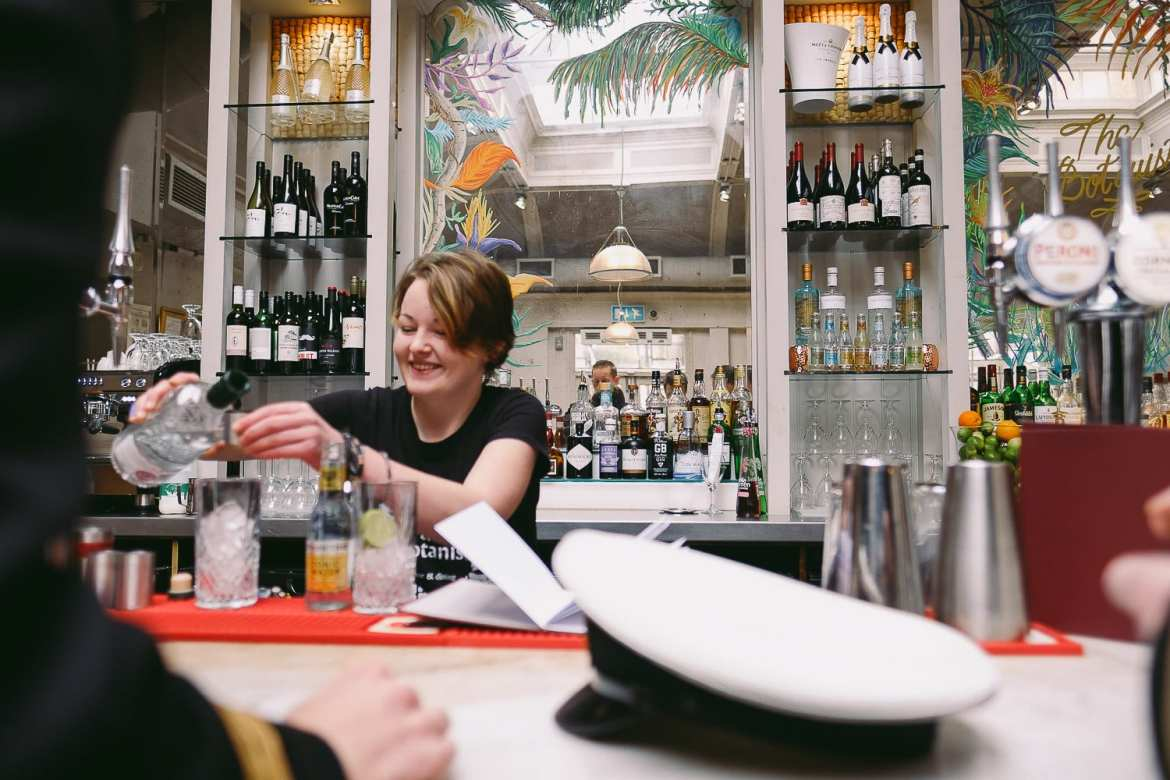 The barmaid at the Botanist pours the drinks