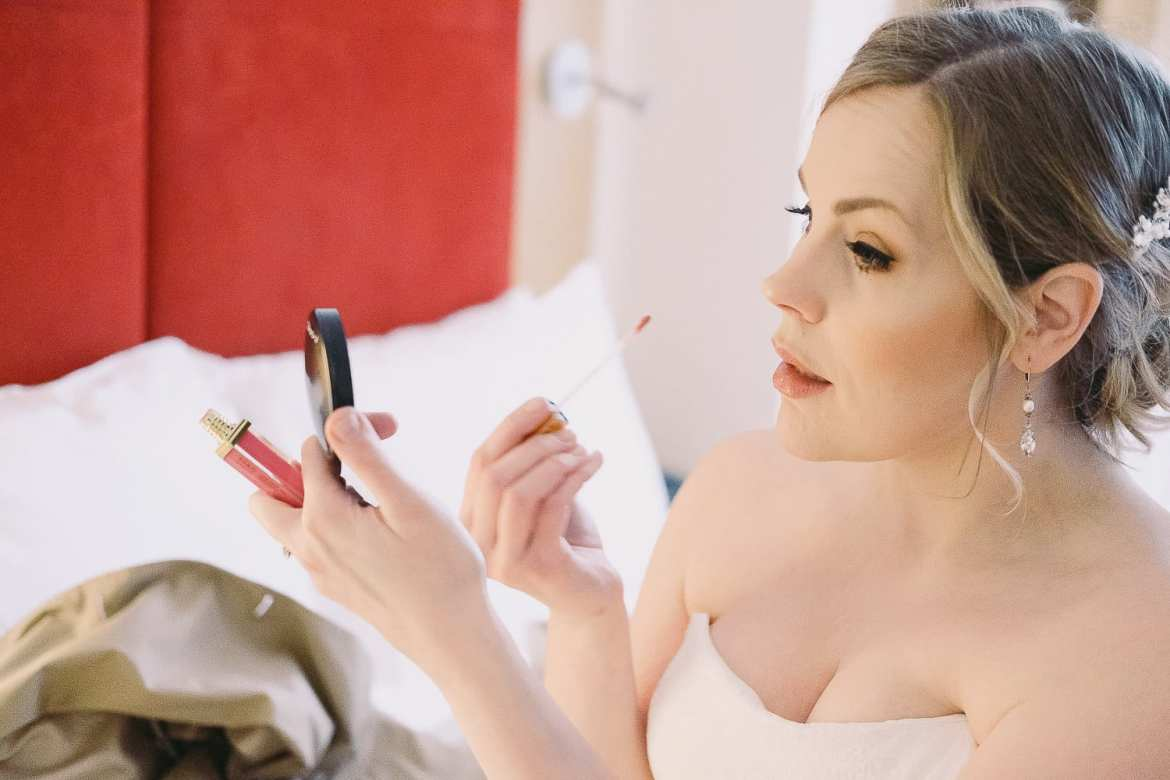 The bride does her make up