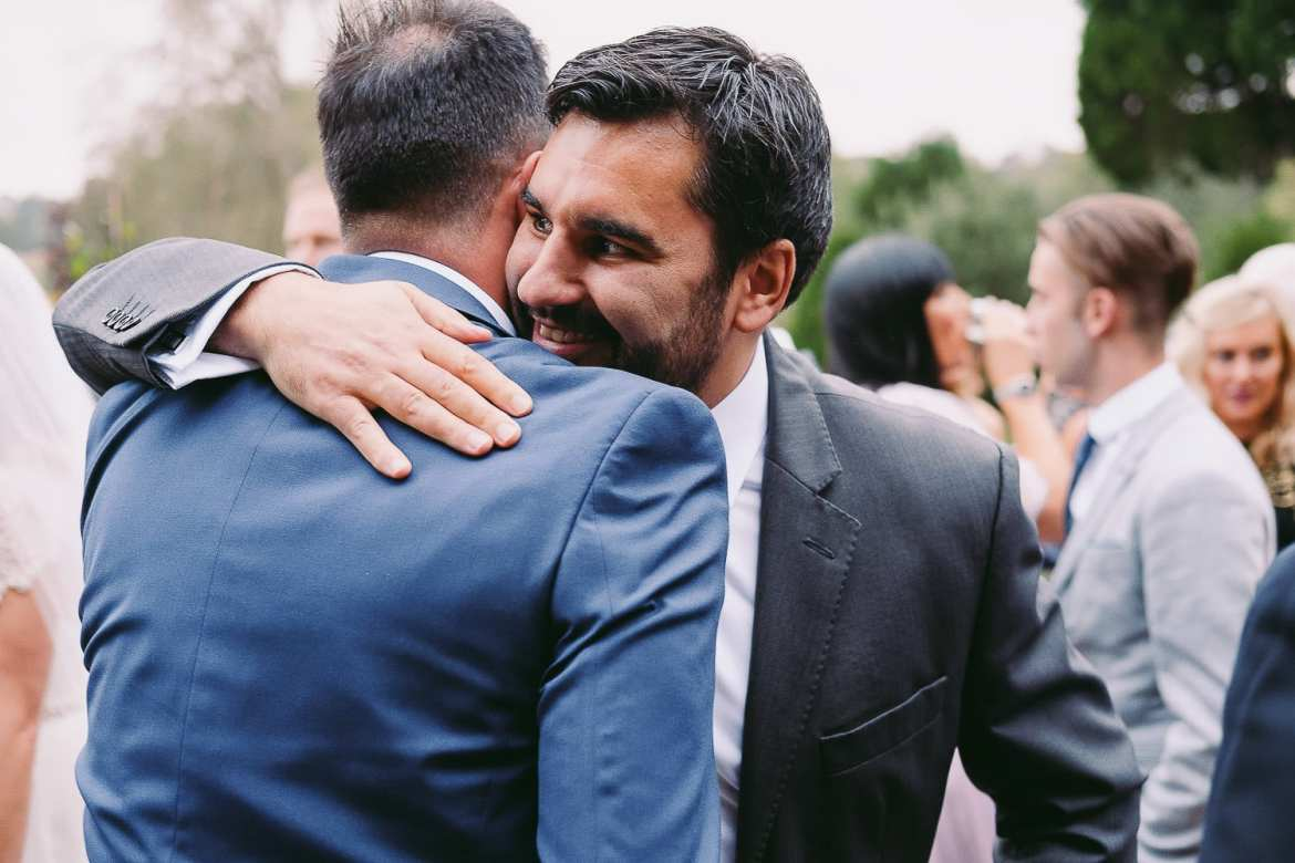 Wedding guests greet each other