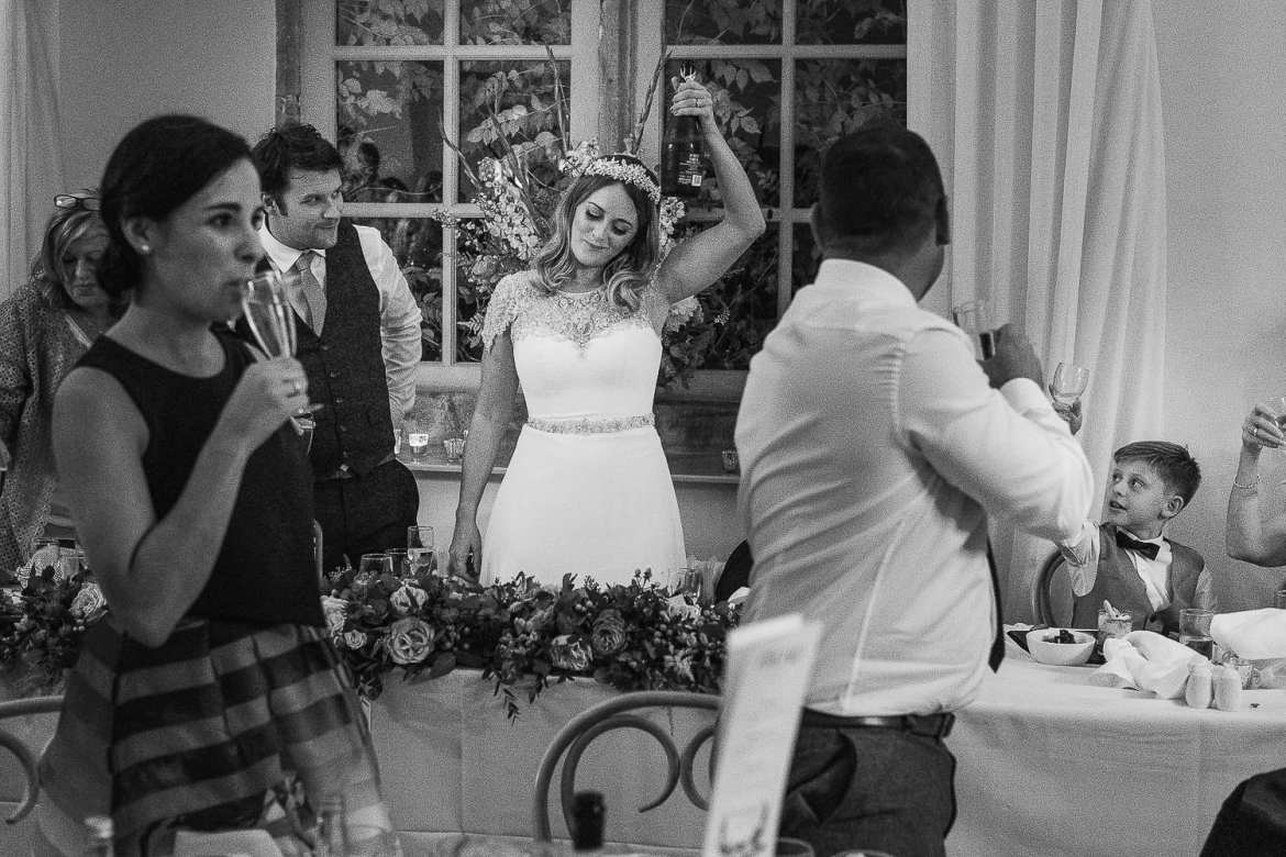 Toasting the bride and groom in the ballroom at Brympton House