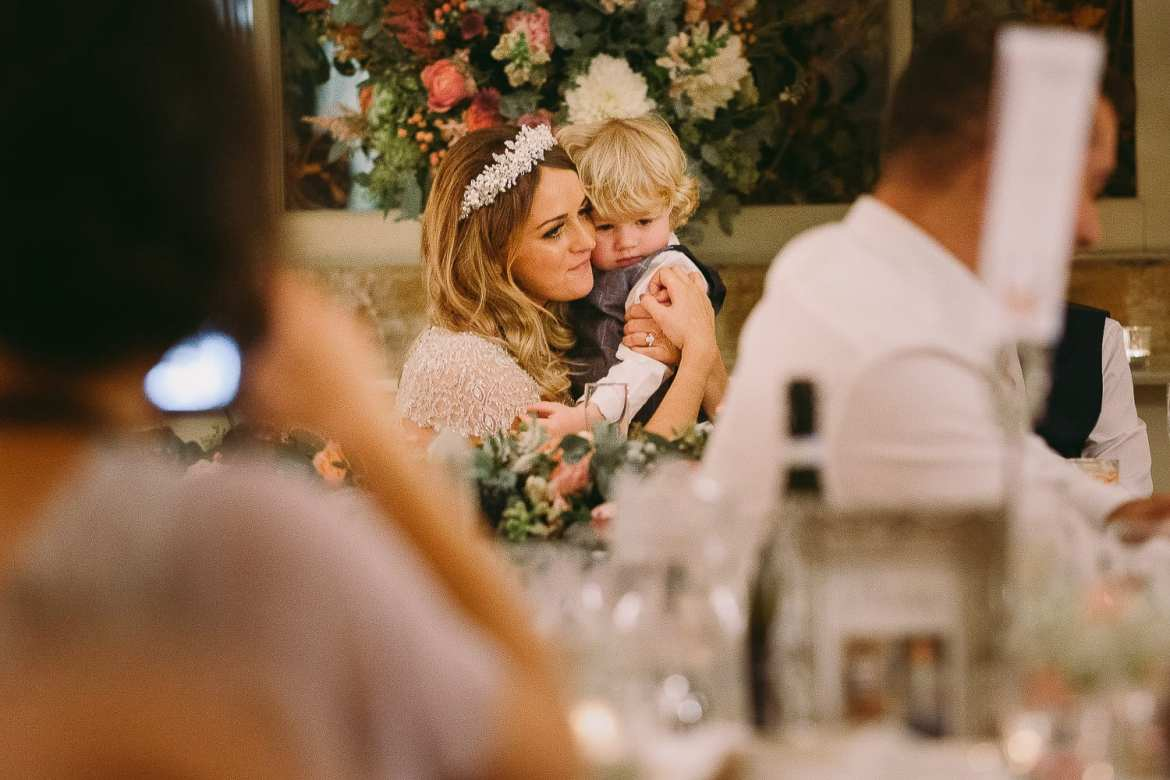 The bride hugs her son after the wedding breakfast