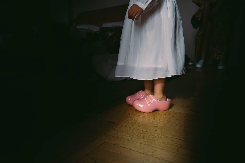The flower girl wears clogs