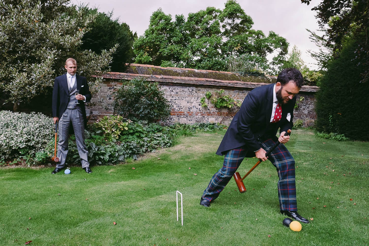 Wedding guests play croquet