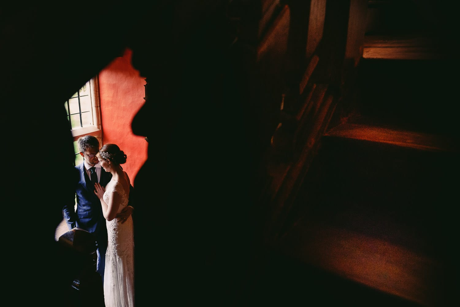 The bride and groom on the stairs at Elmore Court