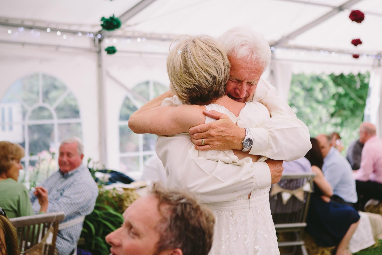 Dad hugs his daughter