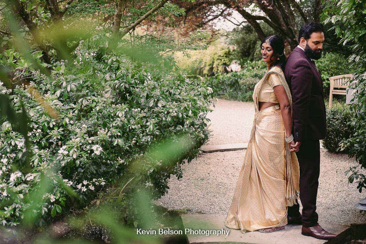 A portrait of the bride and groom in the garden at Matara