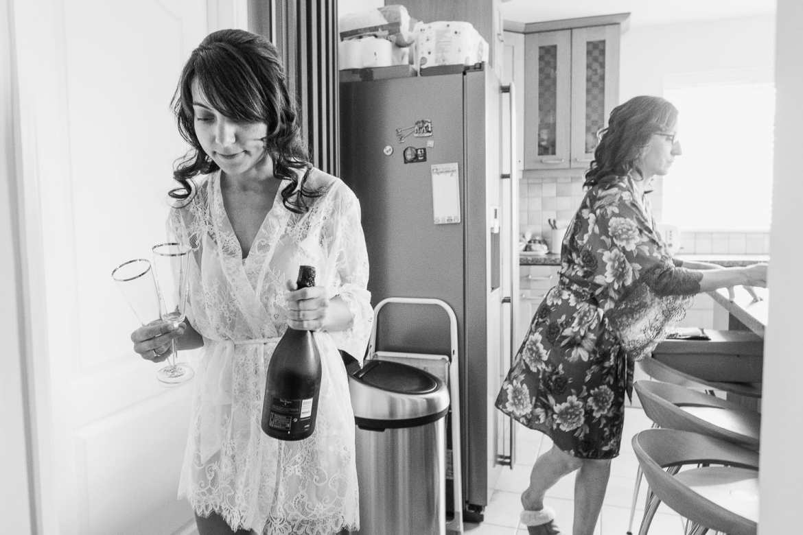 The bride with a bottle of champagne