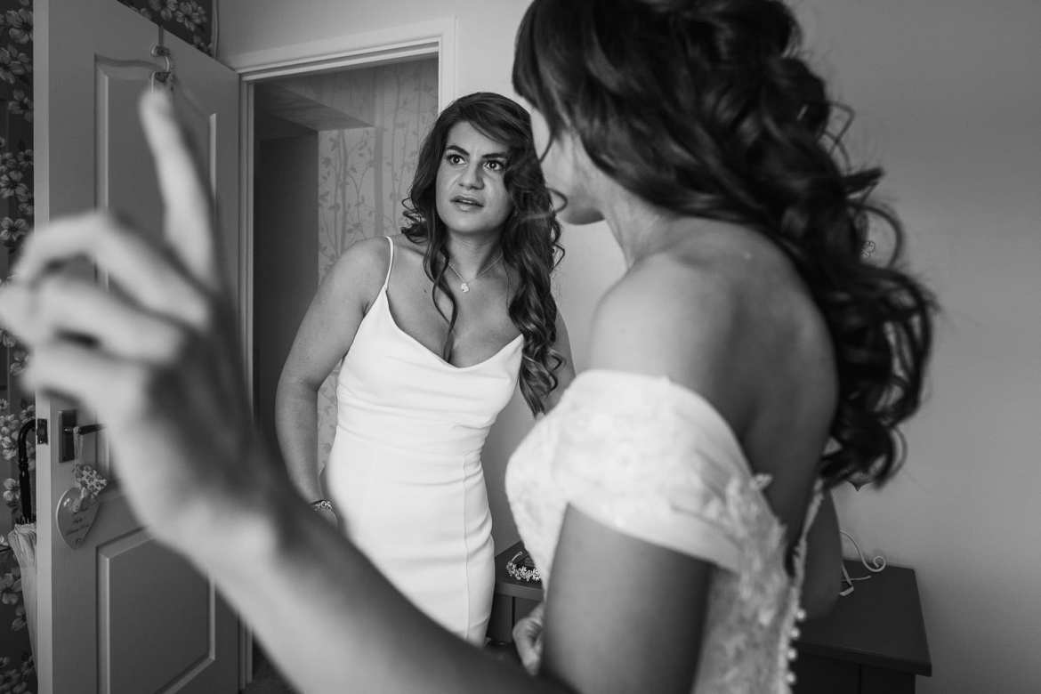 the bride and bridesmaid in the prep room