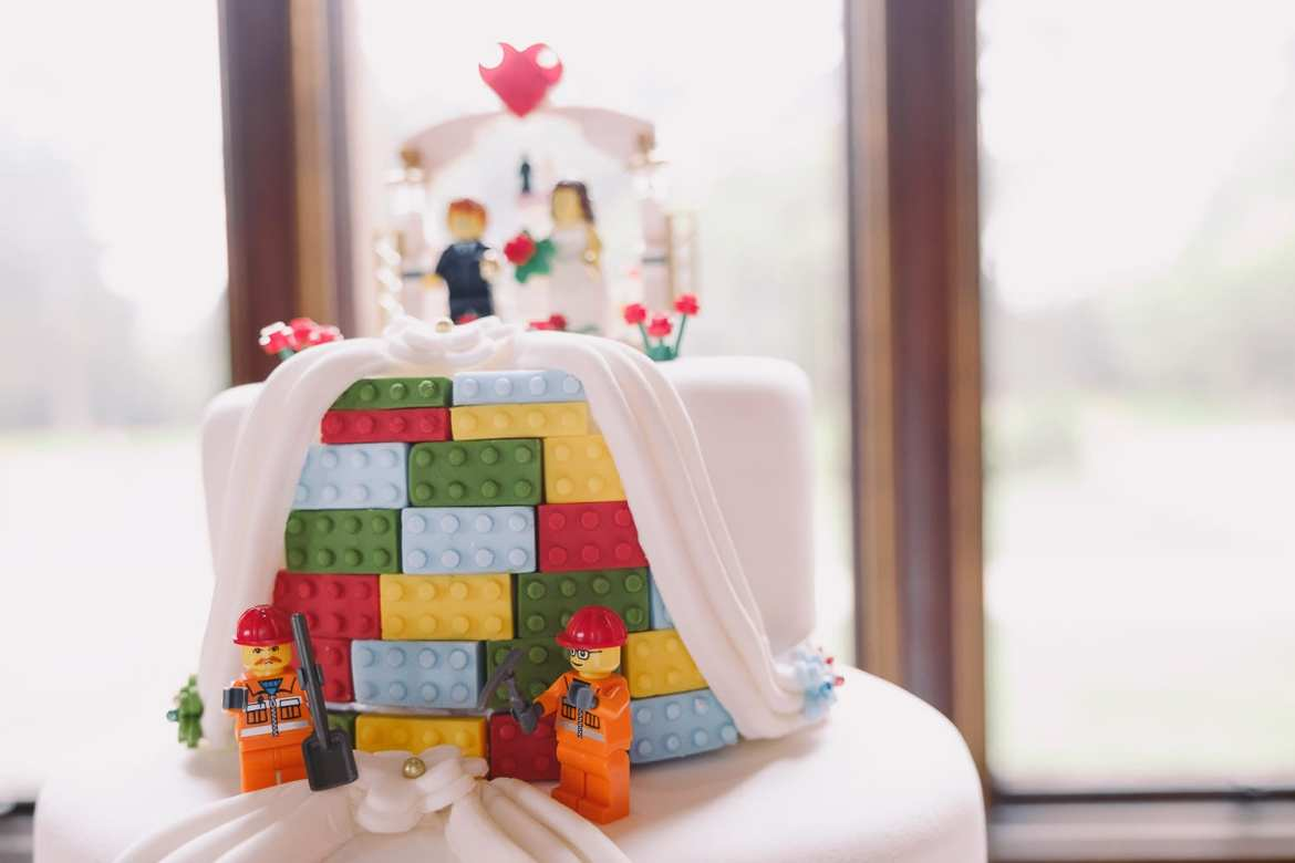 the lego wedding cake was made by the mother of the groom