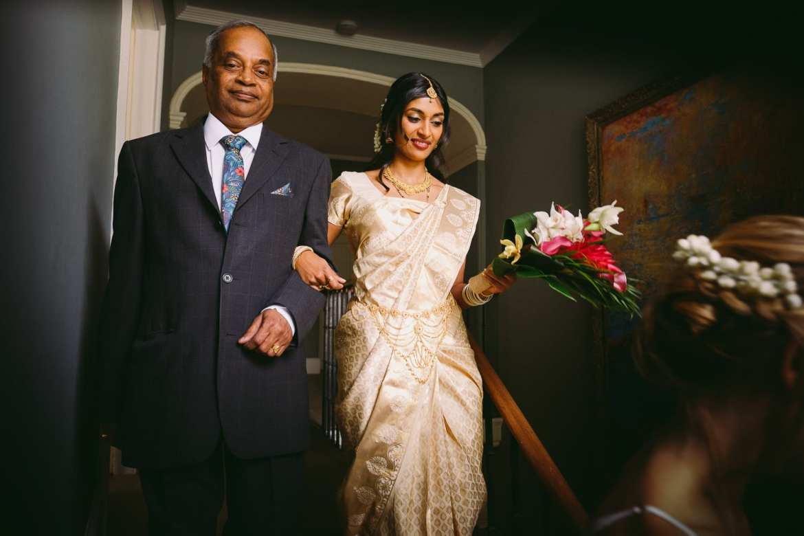 the indian bride and her dad head to the ceremony at matara