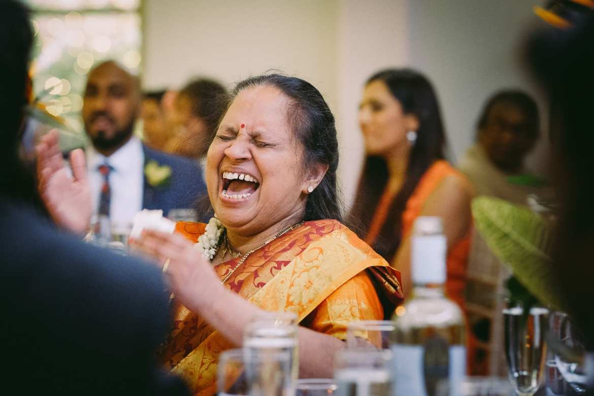 the mother of the bride laughing