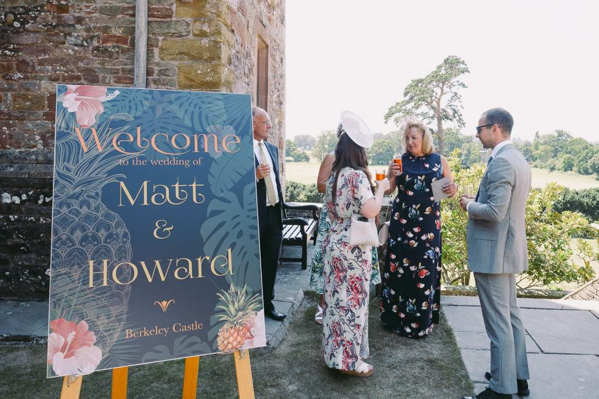 A sign welcomes guests to the wedding at Berkeley Castle