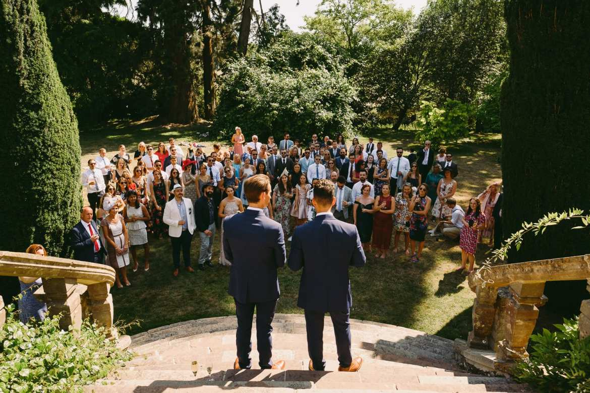 The grooms make their speeches on the steps