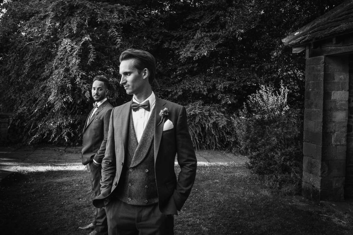 A portrait of the grooms in the gardens at Berkeley Castle