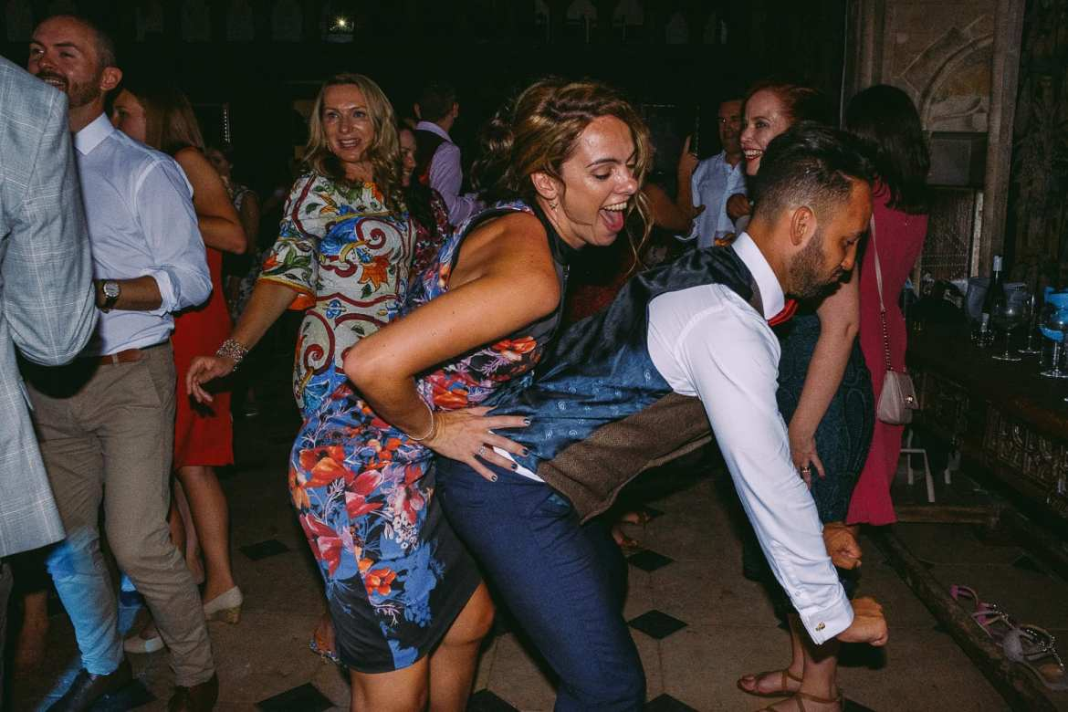 One of the grooms twerking with a guest