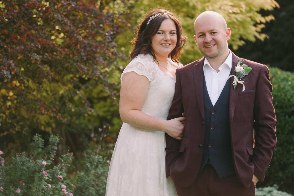 Autumn portrait of the bride and groom in the gardens