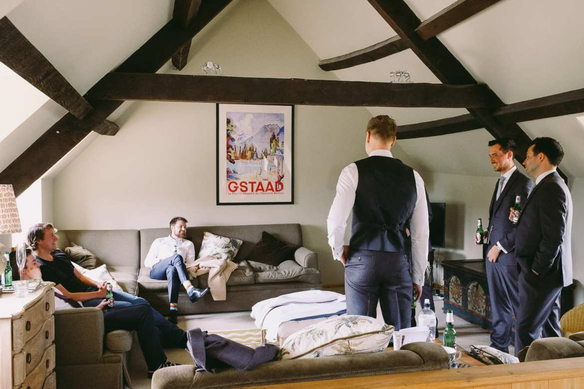 Groom and groomsmen getting ready for the cotswolds wedding at Stone Barn