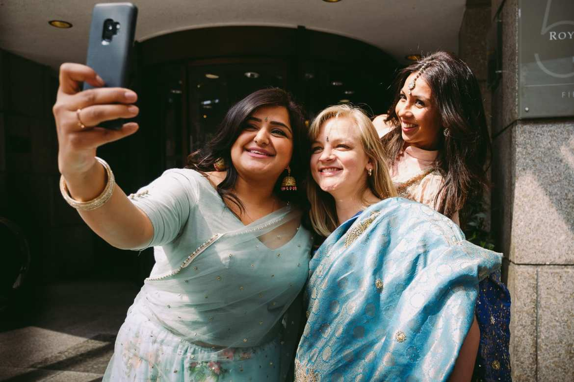 Guests taking the obligatory selfie in their saris