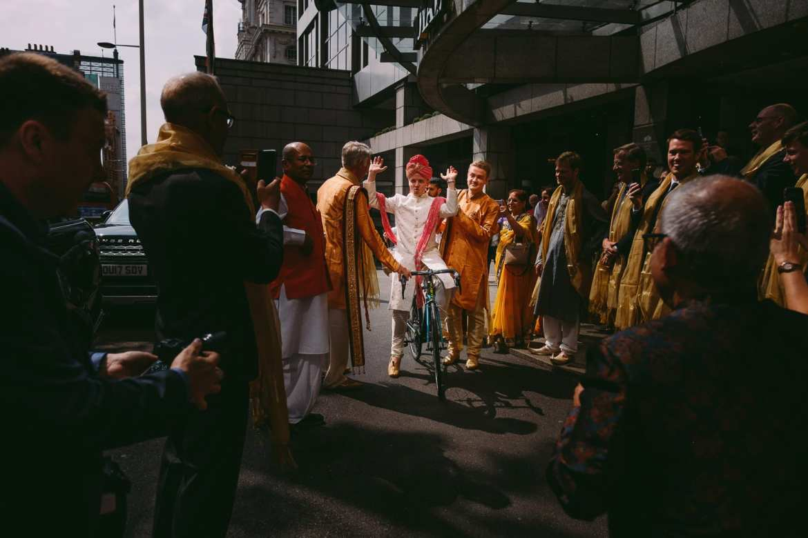 The groom arrives for his Indian ceremony