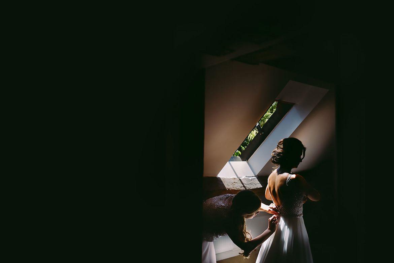 bridesmaid helping the bride