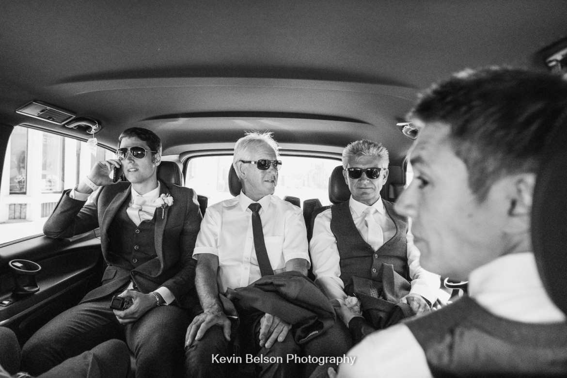 groomsmen in the car
