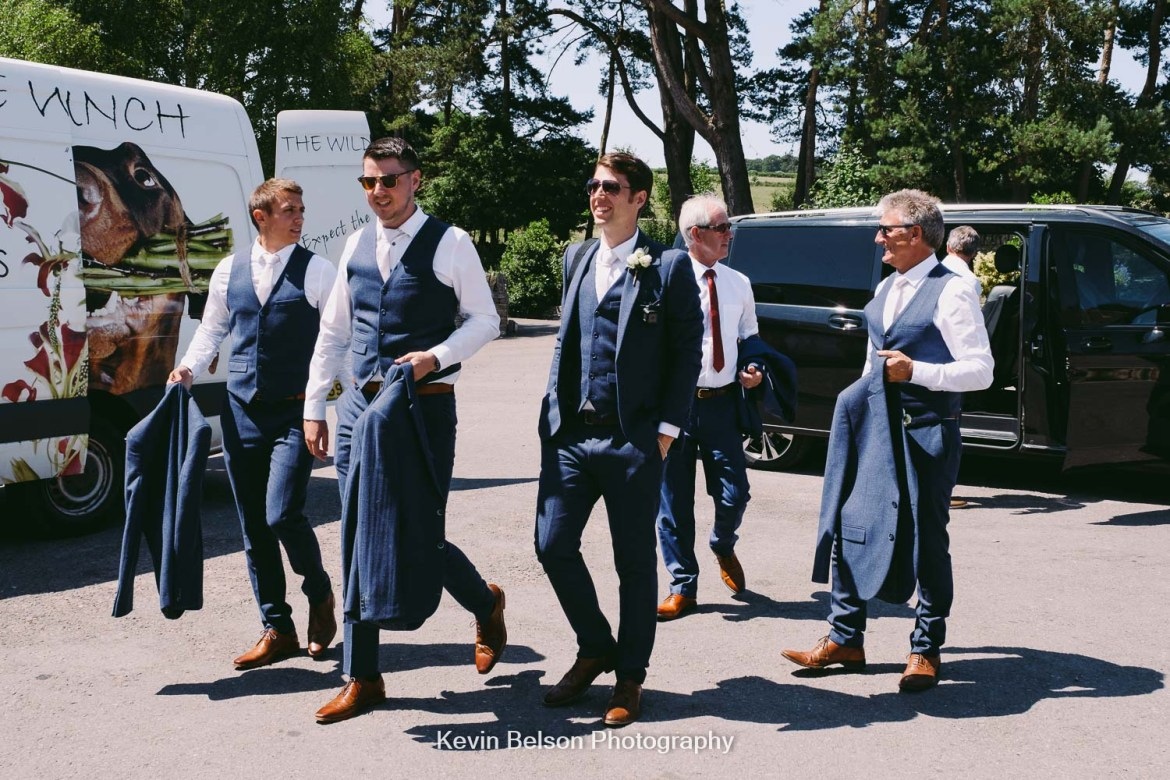 groom and groomsmen arrive at the barn