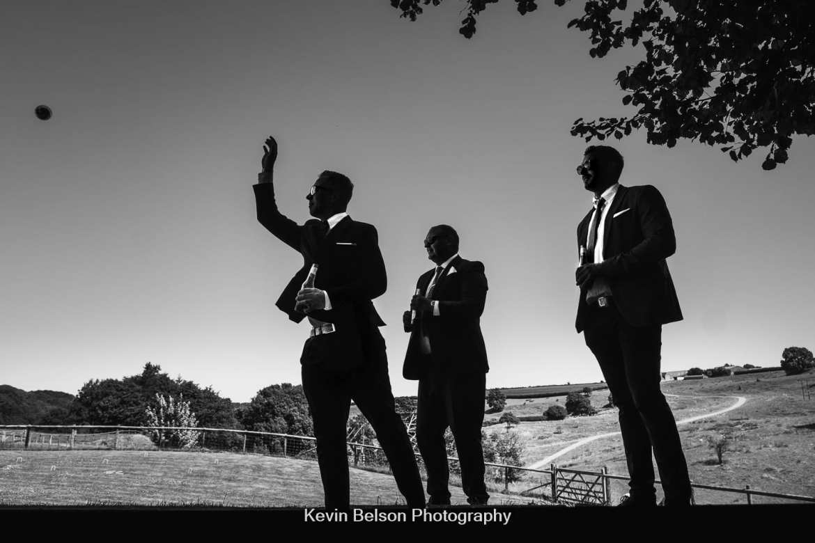 silhouettes of guests playing boules