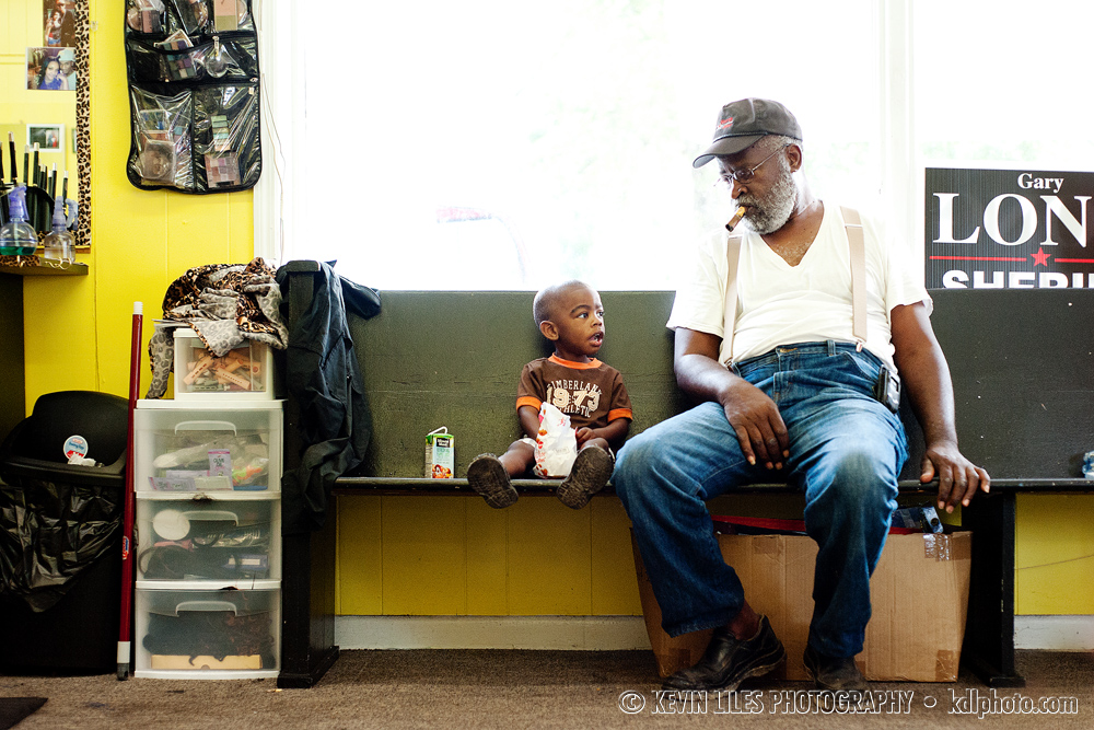 Ralph Evans checks out the new haircut on his 2-year-old grandson, J.J., at Flip's Barber Shop in Jackson, GA.