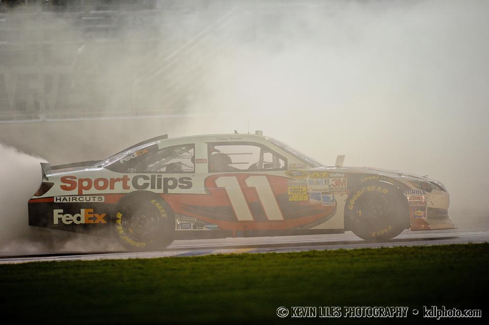 NASCAR Sprint Cup Series driver Denny Hamlin (11) celebrates winning the AdvoCare 500 at Atlanta Motor Speedway.