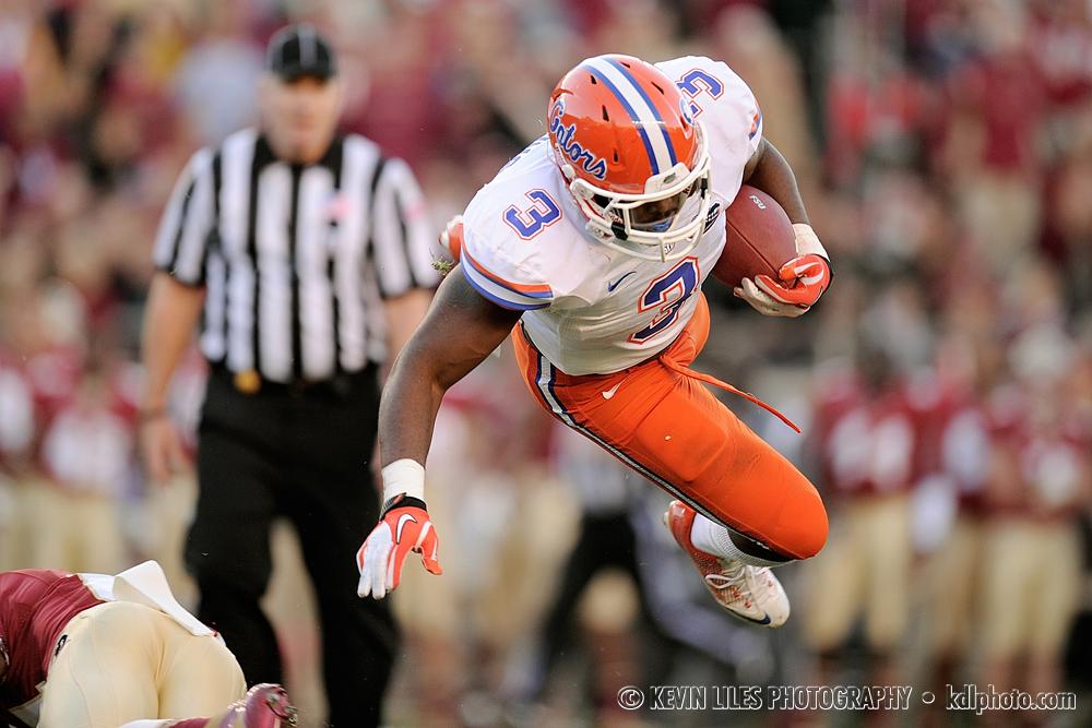 Florida Gators' Jelani Jenkins goes airborne against the Florida State Seminoles at Doak Campbell Stadium.