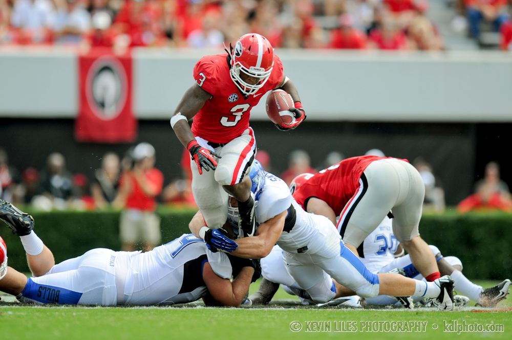 UGA running back Todd Gurley carries the ball against the University of Kentucky at Sanford Stadium.