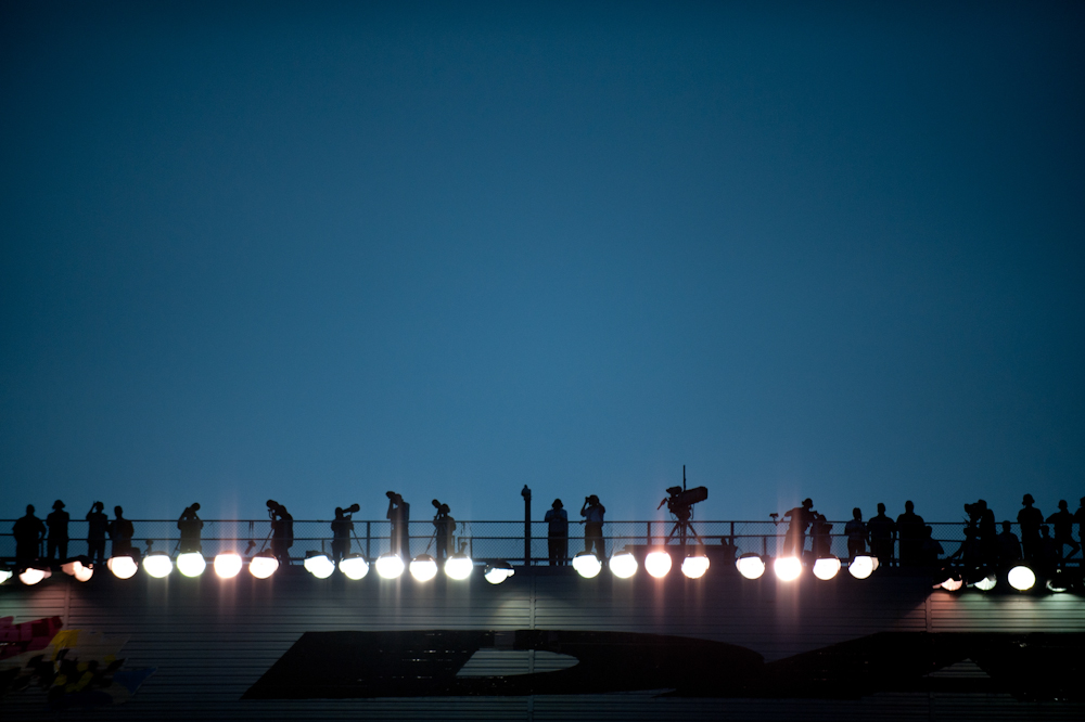 Spotters and photographers on the roof during the NASCAR Sprint Cup Series Coke Zero 400 at Daytona International Speedway.