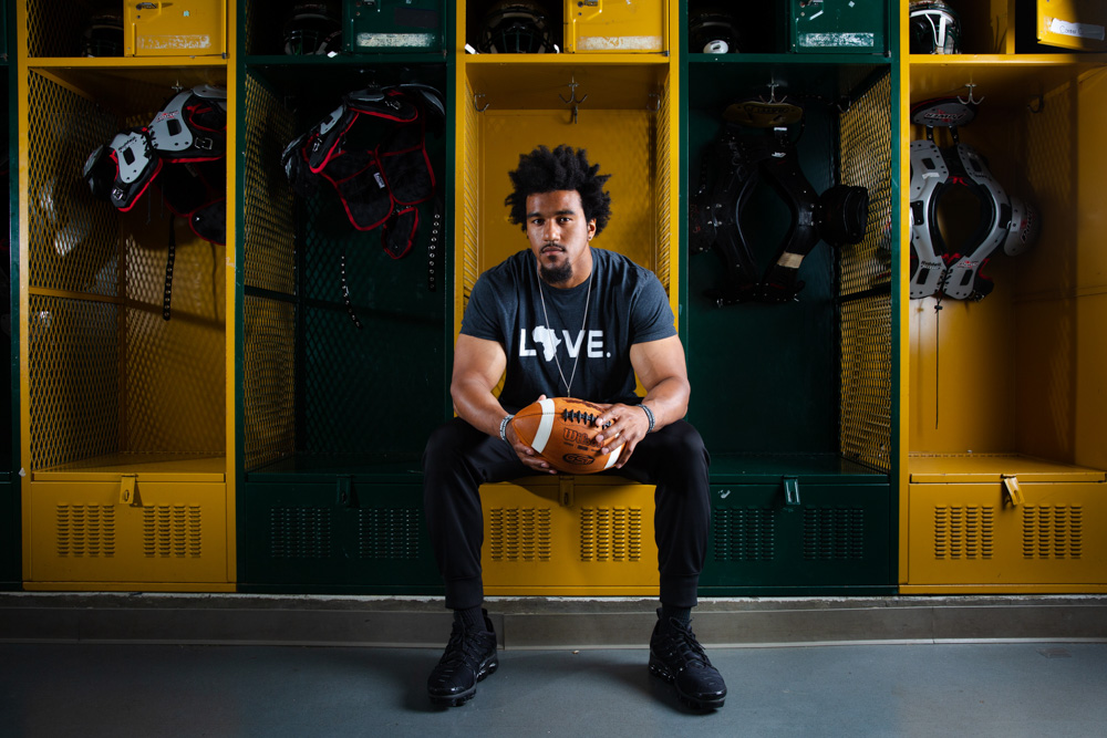Vic Beasley poses for a portrait in his high school locker