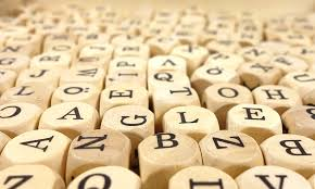 Image of dice with letters instead of numbers