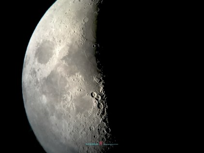 The Surface of the moon is like a A-like Wedding dress with greys silk lining with heavy cratered white embroidery lacy chiffon wool shell revealing the story of the Jade Rabbit also the Apollo Lunar Missions....