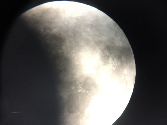 As the Supermoon is cased by the Earth Shadow Umbra.. slowly seen in the Cyclone Fehi Auckland skies..