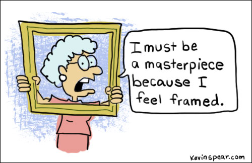 Cartoon of a woman holding a picture frame