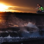 Sun Sets In The Distance, Man Catches Big Air