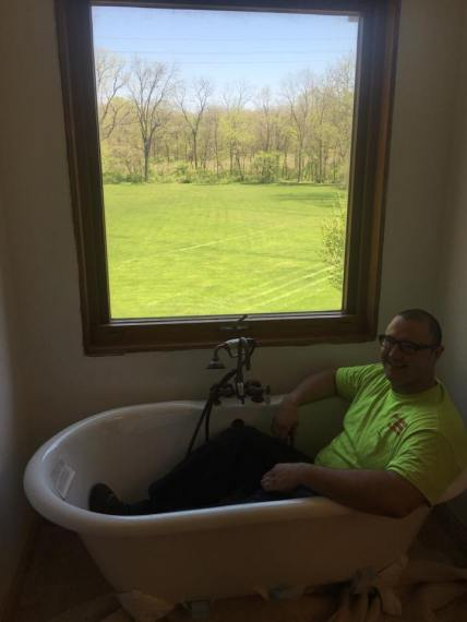 kevin-szabo-jr-having-fun-while-installing-free-standing-tub-in-bathroom-remodel