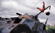 James Nachtwey 'Boy On Tank, Nicaragua' 1984.