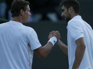 Tomas Berdych and Marin Cilic in darkness (Ben Curtis/AP)