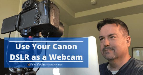 smiling man using DSLR as webcam