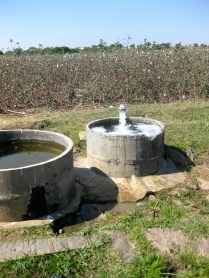 Water being pumped from the well into a collection basin.