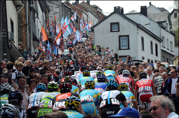 The peloton of the classic Liège-Bastogne-Liège is saluted by a mass of people
