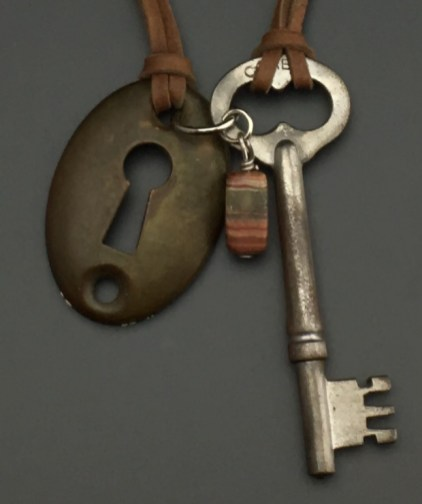 "American ""Owl Eye"" Key with Escutcheon, on doe skin - $43 (SW814)"