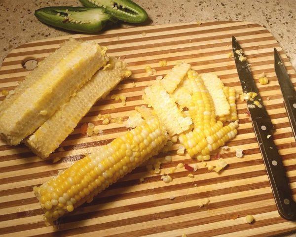 Cutting corn off the cob for salsa