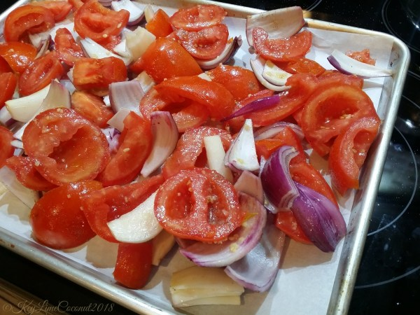 Tomatoes and onions prepared for roasting