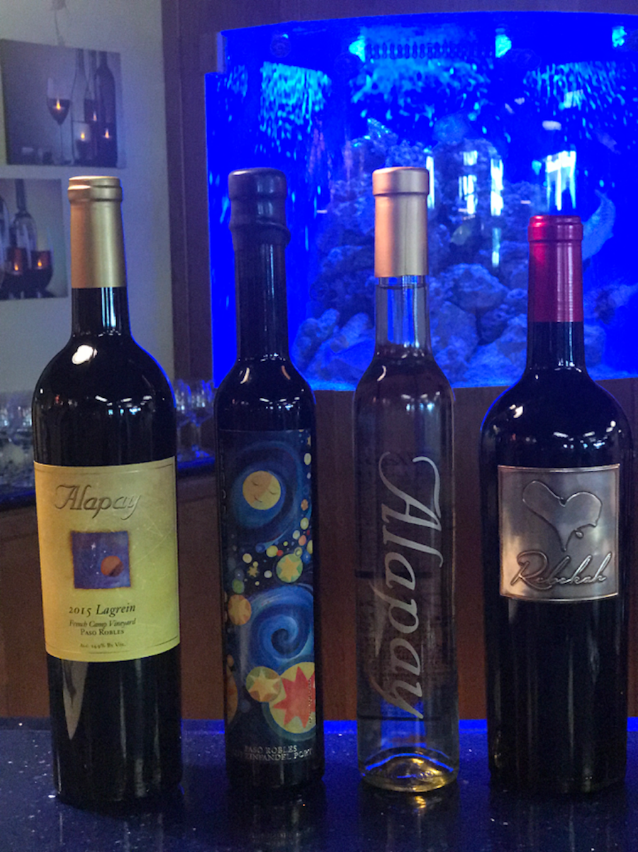Belly up to the tasting room bar and be entertained by the staff and colorful fish in the giant salt water tank in the Alapay Cellars tasting room.